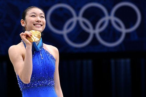 South Korean figure skater Yuna Kim wins the gold and sets a new world record at the XXI Winter Olympics in Vancouver, Feb. 25, 2010.