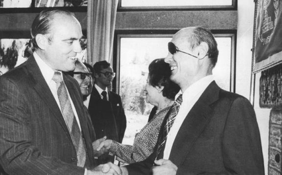 Moshe Dayan, former Foreign Minister of Israel, greets U.S. Ambassador Samuel Lewis at the New Year (Rosh Hashana) reception of the President of Israel for the Diplomatic Corps, September 9, 1977. Credit: Jerusalem-Korczak-Home.com