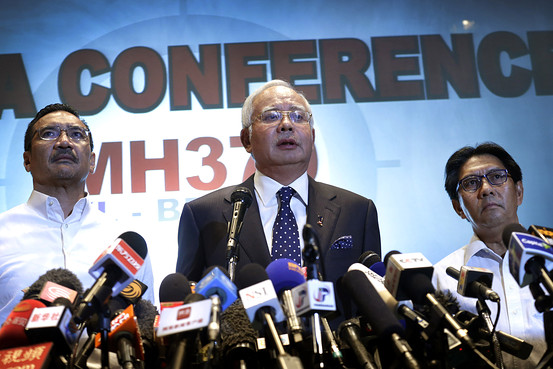 Malaysian Prime Minister Najib Razak, center, Malaysia's Minister for Transport Hishamuddin Hussein, left, and director general of the Malaysian Department of Civil Aviation, Azharuddin Abdul Rahman, deliver a statement on the missing Malaysia Airlines jetliner on Mar. 15, 2014. Credit: Associated Press via WSJ.com