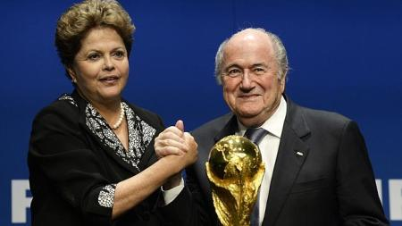 Dilma Rousseff (left) and FIFA president Sepp Blatter (right) with the World Cup trophy. Source: AP