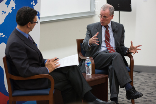 Robert Ford (right), the most recent U.S. ambassador to Syria, engages in conversation with Frank Sesno, director of the School of Media and Public Affairs, at the 4th Annual Walter Roberts Lecture, November 12, 2014. Credit: Alexei Agaryshev.