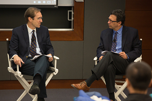 David Ensor (left), director of the Voice of America, does a live interview with Frank Sesno (right), director of the School of Media and Public Affairs, at an event on campus, January 27, 2015.