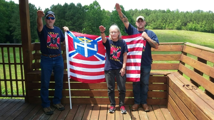 aryan nations members salute flag